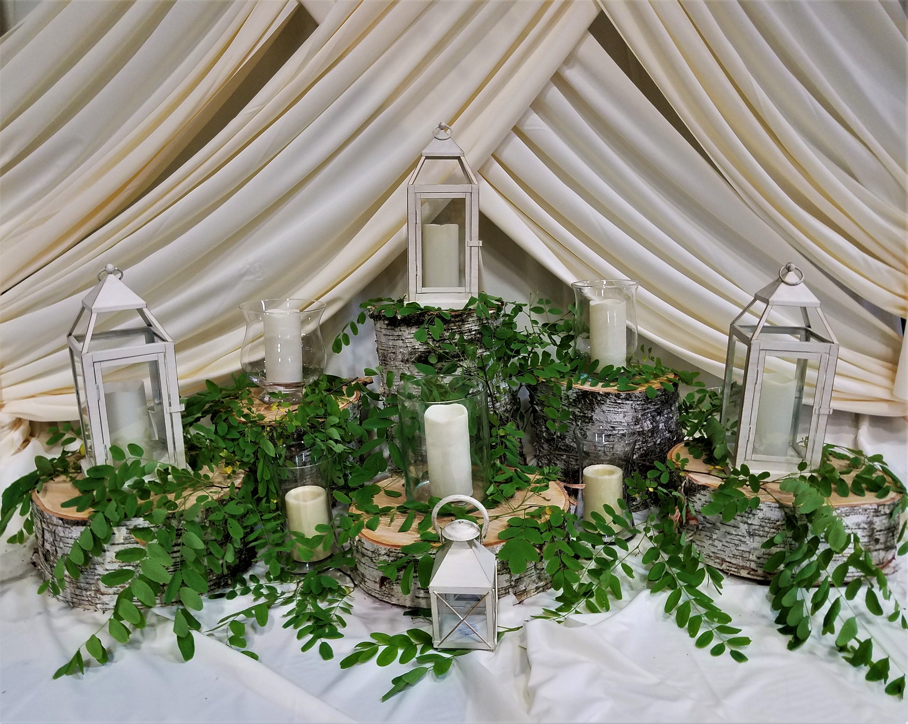 Birch Pillars Stumps With Glass Vases And Metal Lanterns Perfect For Any Event Chelsea Wedding Event Decor Party Rentals