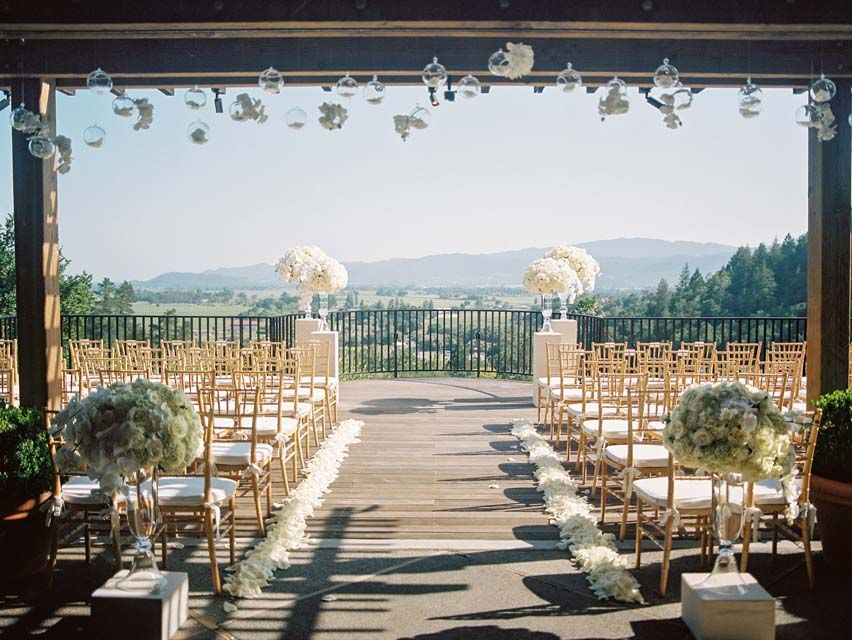 Auberge du Soleil White Wedding Ceremony flowers Urns