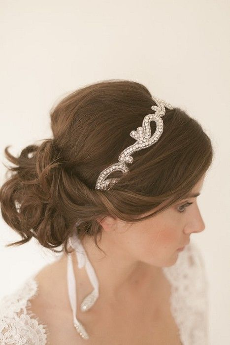 Beautiful soft low bun..maybe with a smaller head band.