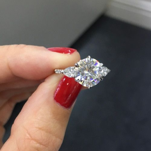 Round Brilliant with Pear Side Stones Engagement Ring Ear