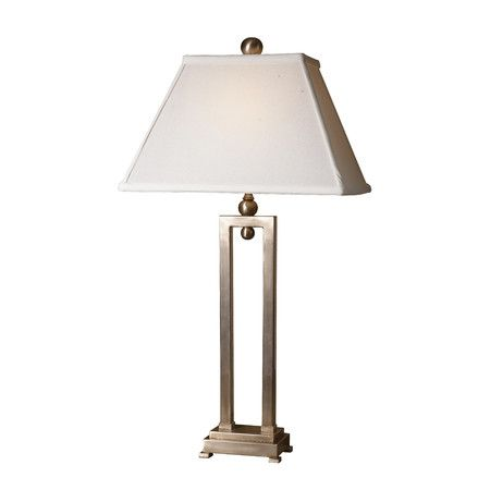 Displaying a contemporary style the uttermost conrad table lamp with empire shade has clean cuts