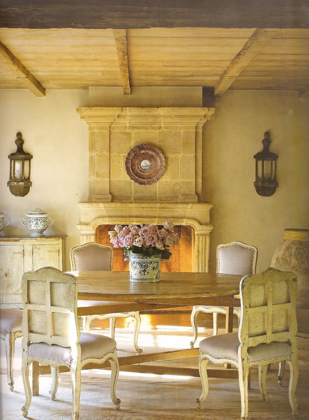 Pretty French country dinning area in front of the fireplace ...