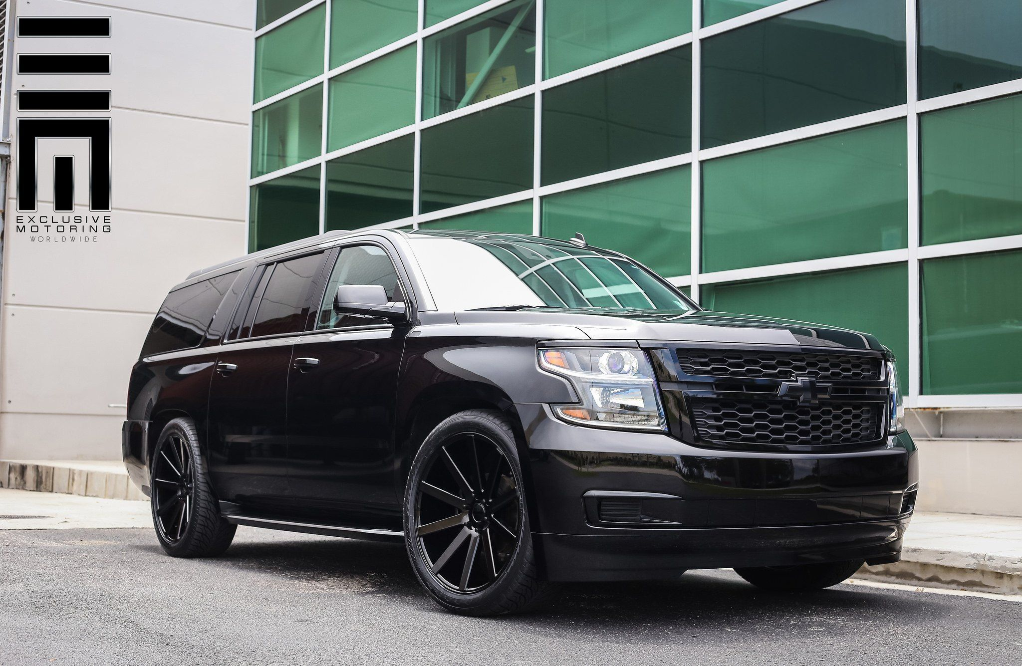 All Black Chevy Suburban On Custom Wheels By Exclusive Motoring Chevy Suburban Custom Wheels Chevy