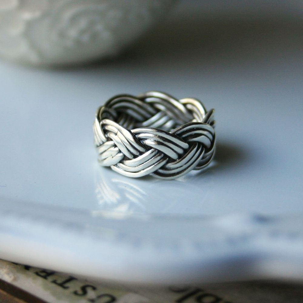 Braided ring... Maybe a thinner version? I'm not a huge fan of thick rings for girls.