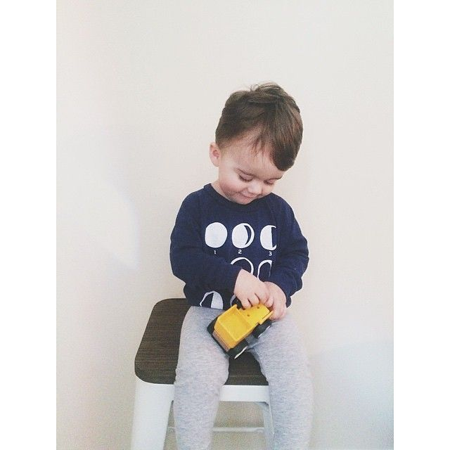 We love this snapshot of @laurenallyson 's little cutie in our Moon Phases Tee! Heart be still! #strawberrymothkiddos #cutecustomers