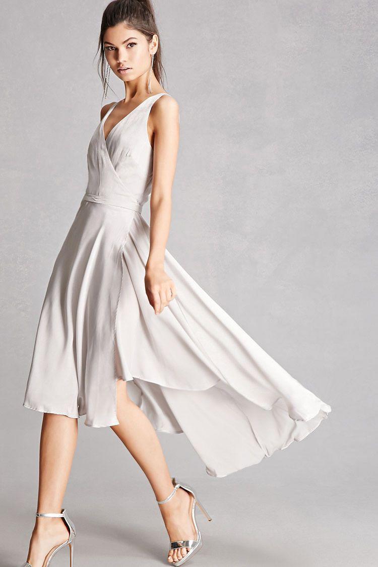 9fe4e9a0c00ba7 A satin wrap dress featuring a surplice neckline