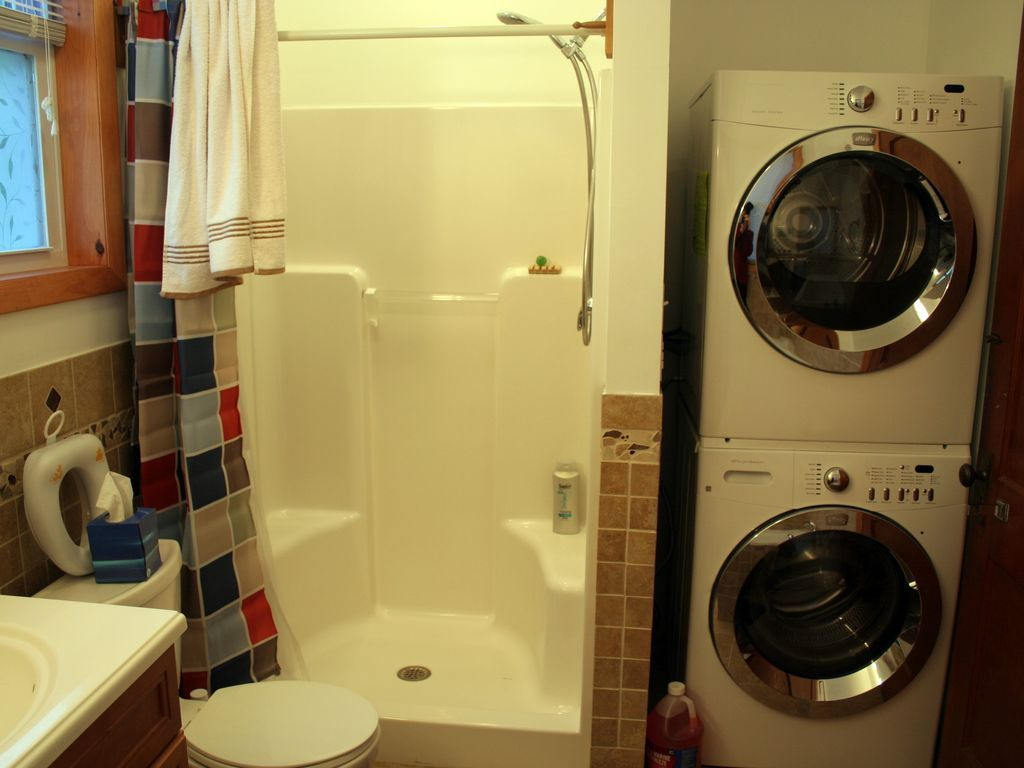Tiled Master Bath Spacious Shower Clothes Washer Dryer Laundry Room Storage Laundry In