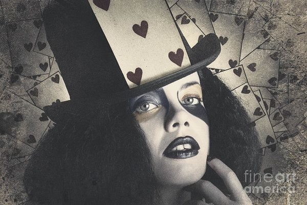 Vintage fashion portrait on the face of a retro woman wearing top hat and heart poker card. Queen of hearts by Ryan Jorgensen