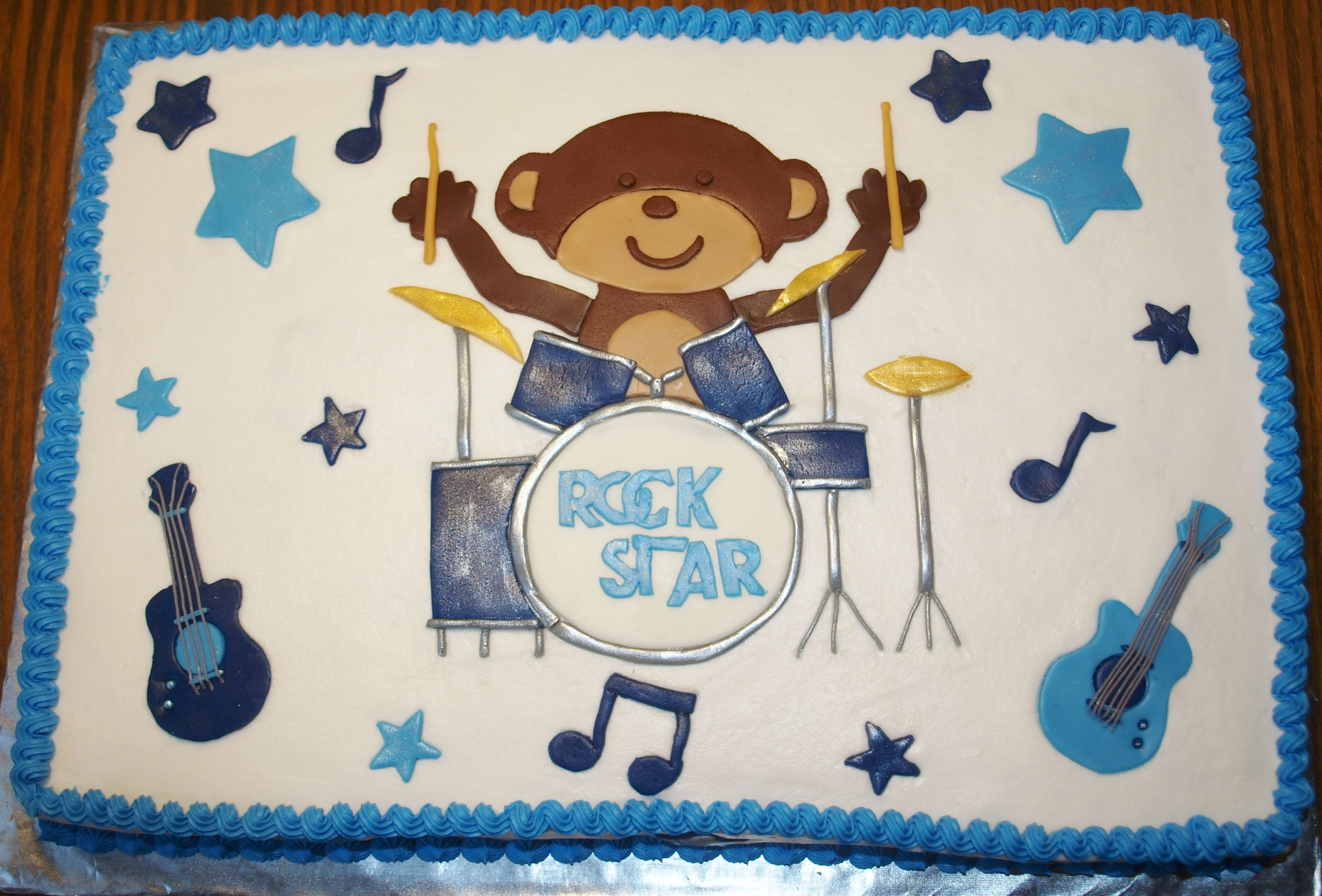 Rock Star Monkey - For a friends baby shower,theme was Rock Star Monkey by Carters. Dad plays drums so I made monkey playing drums instead of guitar. French vanilla cake & frosting, designs are mm fondant.