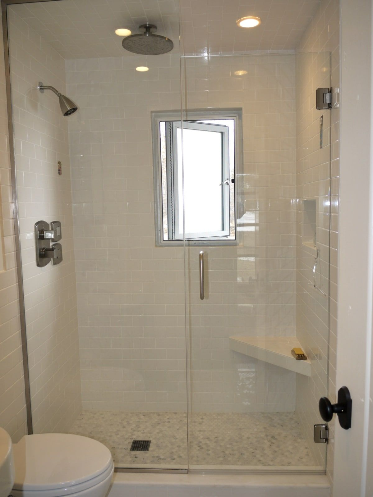 Finished walking in shower with heavy glass door and white subway ...