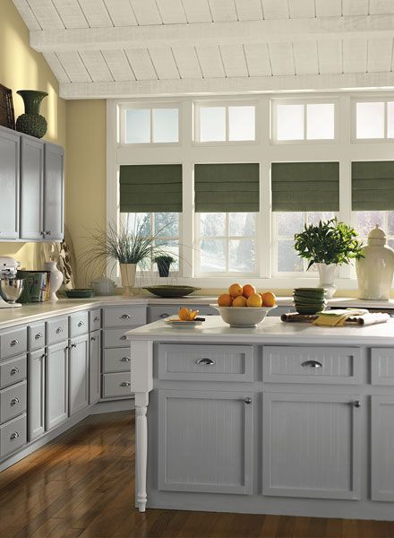 Gorgeous gray kitchen with a splash of yellow bm storm on for Kitchen paint colors gray