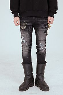 Redhomme Destroyed Black JeansPut a grungy touch to a glam outfit with this destroyed black jeans. Stylish guys everywhere will rejoice in these low rise jeans` five pocket styling, ripped portions all over, and patched portions. They look captivating when paired with an embellished and printed gray sweater, purple sneakers, and a black cocoon coat.