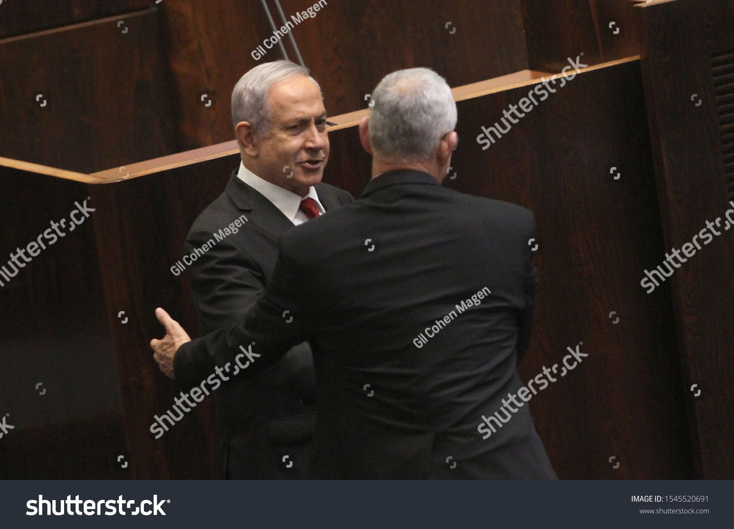Israels Prime Minister Benjamin Netanyahu shake Hands with Blue and White party leader Benny Gantz during a memorial for the slain cabinet minister Rehavam Zeevi at the K...