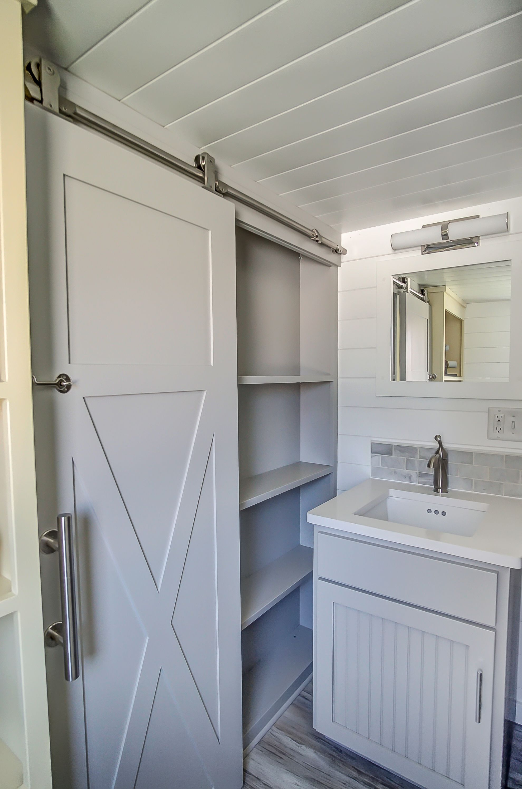 sneaky storage behind the sliding bathroom barn door in the fox a rh pinterest com