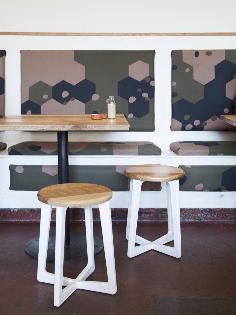 Banquette seating with camouflage canvas upholstery at