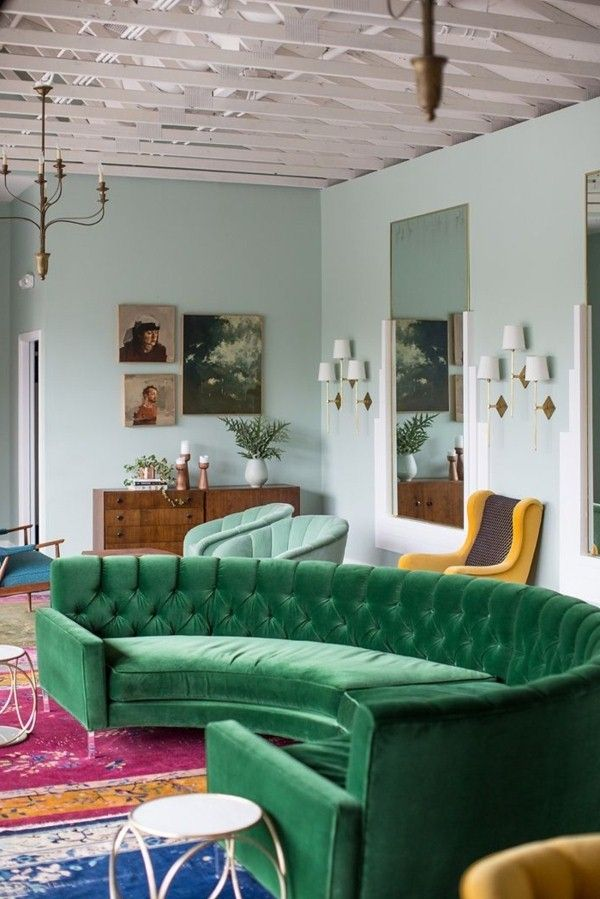 green sofa in a semicircular form