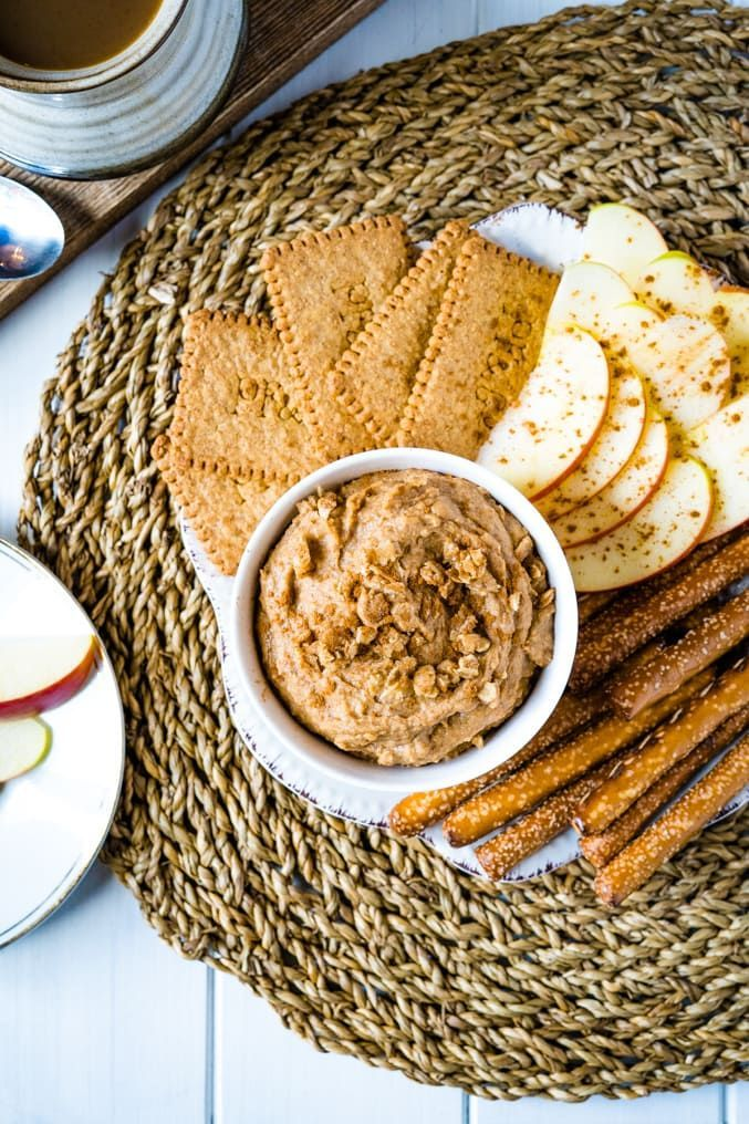 Snickerdoodle Dessert Hummus -  a sweet twist on traditional hummus using chickpeas but with some cinnamon and sweetness for a deliciously sweet and healthy snack.  Perfect for dipping cut up apples or a few pretzels for a quick healthy snack. Even better... it is also vegan and gluten-free! #desserthummus #desserthummusrecipe #desserthummushealthy #glutenfreesnacks #vegansnacks #healthyvegansnacks #21dayfixrecipes #21dayfixcheatdaysnacks #21dayfixsnackrecipes #healthysnackrecipes #... #desser #desserthummus