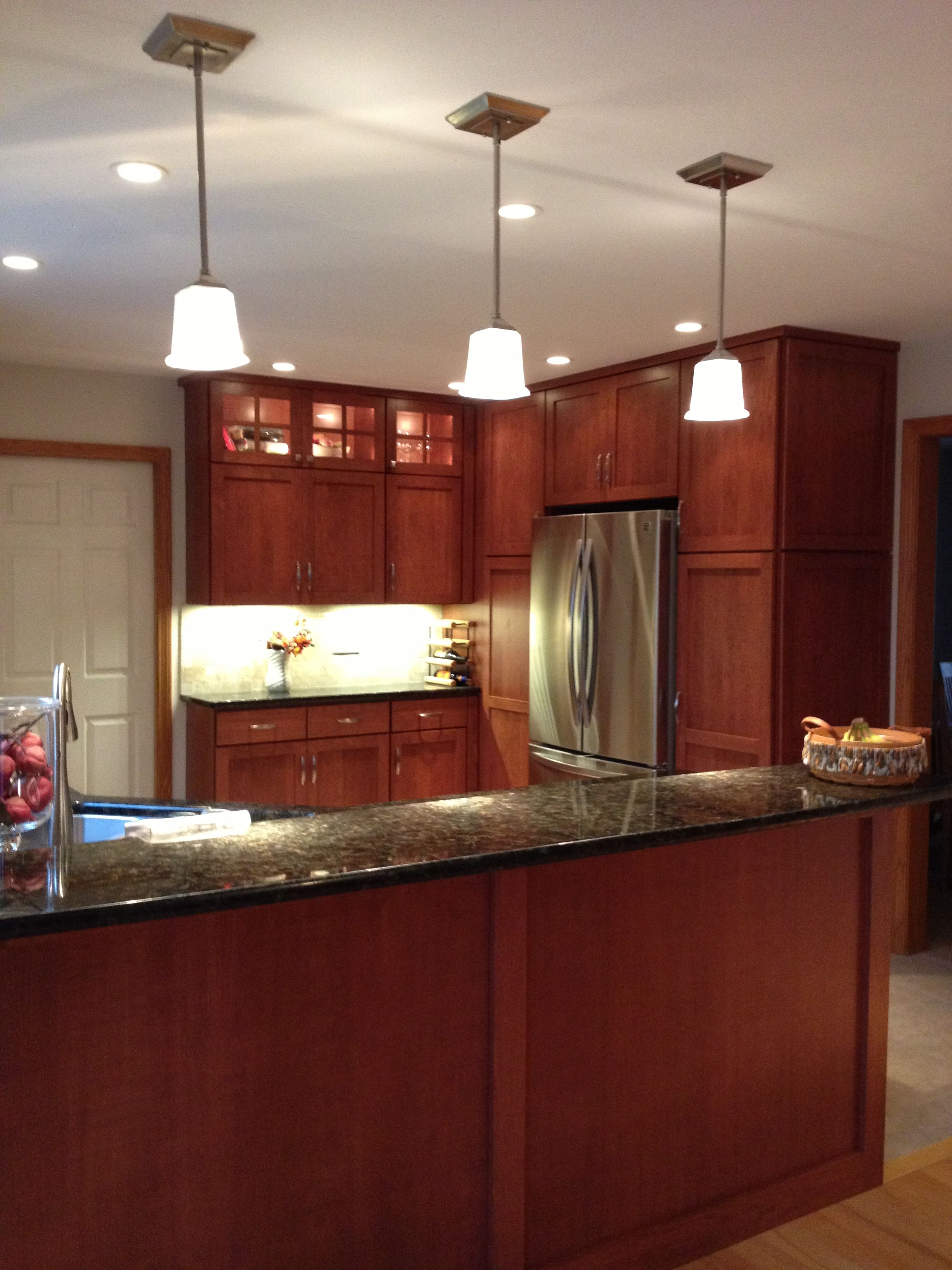 New shaker style cherry cabinets replace a