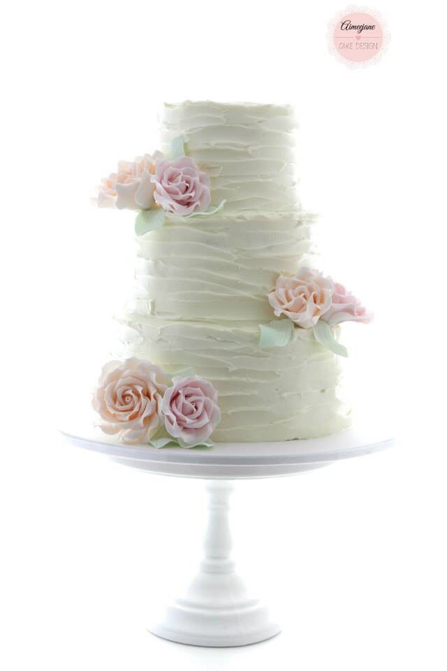 Rough Iced Wedding Cake With Pink And Peach Roses