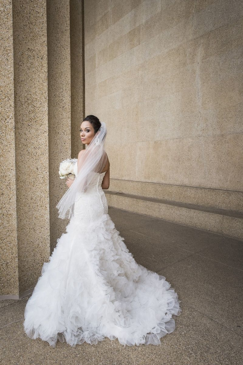Strapless Mark Zunino Wedding Gown    Photography: McLellan Style   Read More:  http://www.insideweddings.com/weddings/nfl-tennessee-titans-players-gold-white-wedding-in-nashville-tn/652/