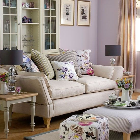 Purple living room with floral soft furnishings