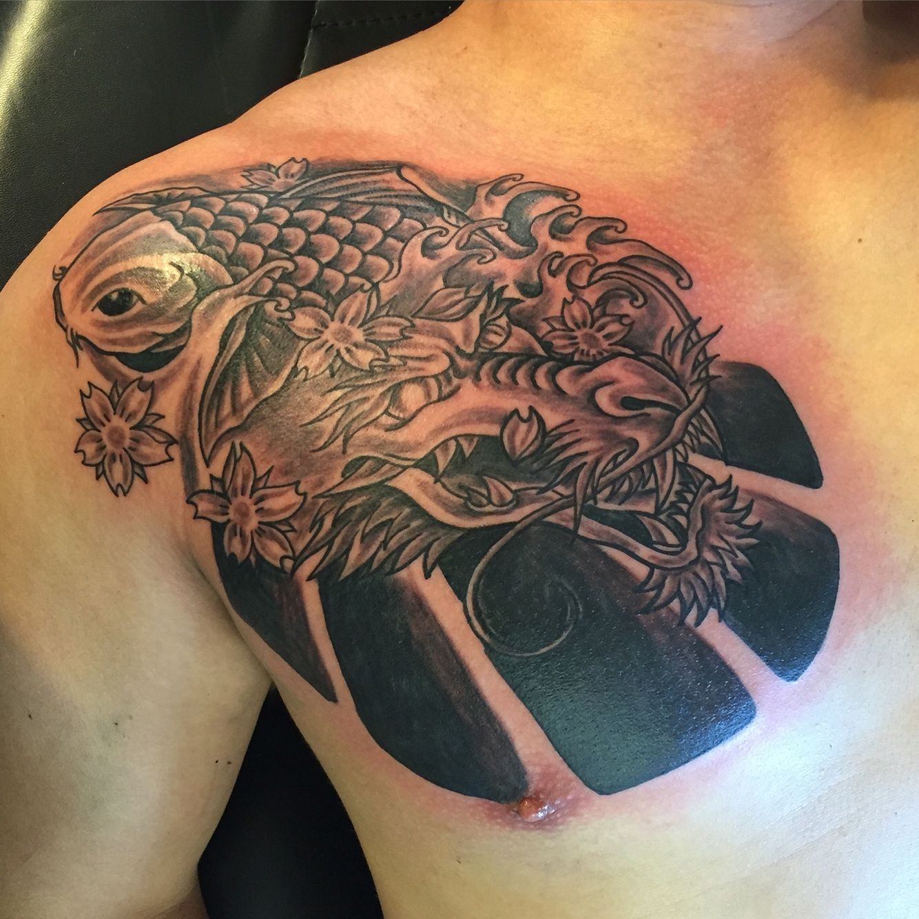 Dragon With Koi Fish Chest Tattoo
