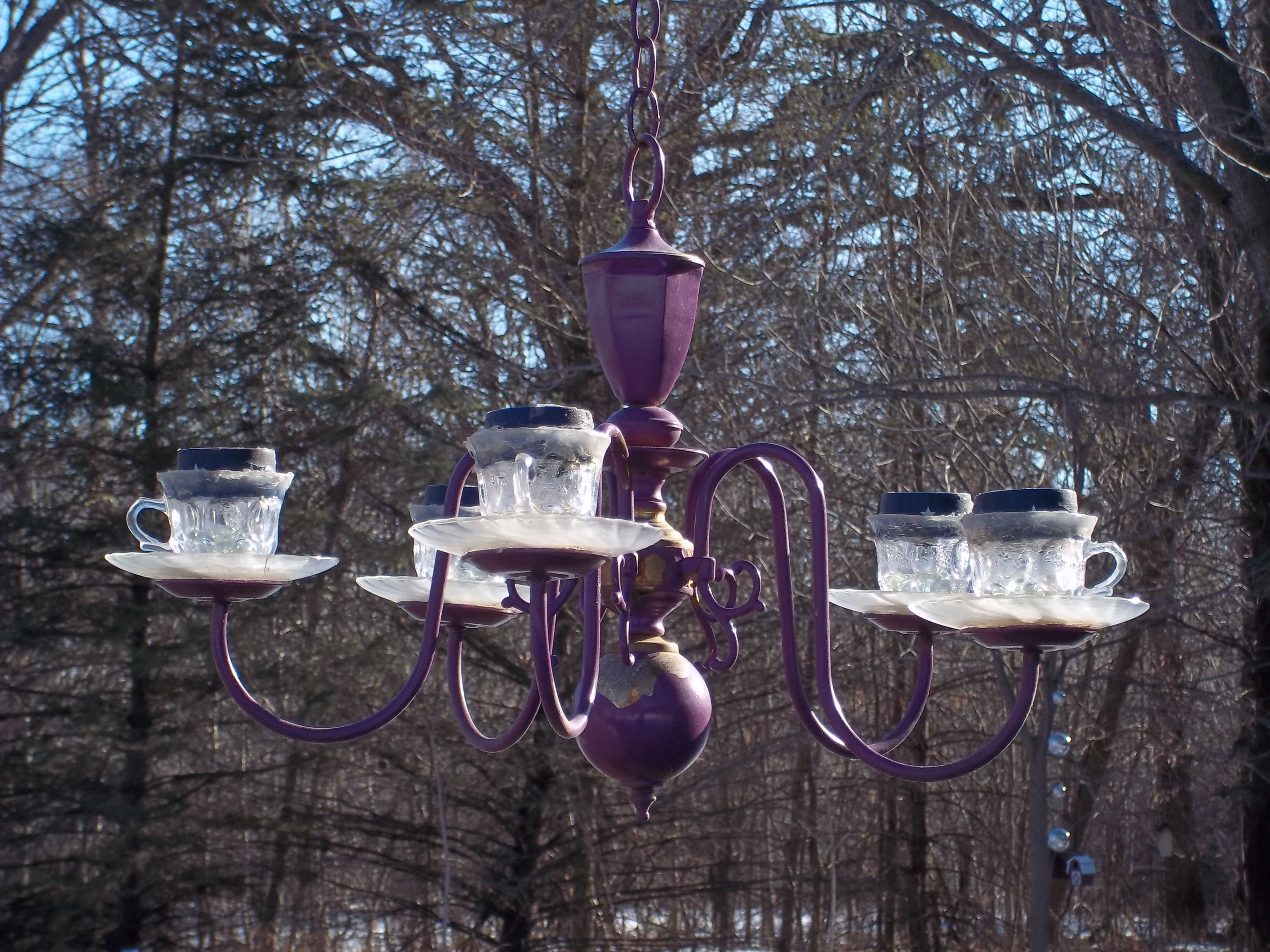 I used clear coffee cups saucers and solar lights to light up this i used clear coffee cups saucers and solar lights to light up this painted chandlier arubaitofo Choice Image