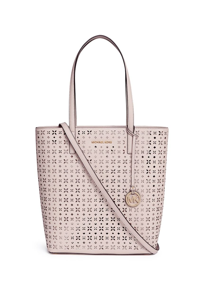 cacf70267762 MICHAEL KORS  Hayley  Large Floral Perforated Leather Tote.  michaelkors   bags  tote  leather  lining  metallic  shoulder bags  hand bags