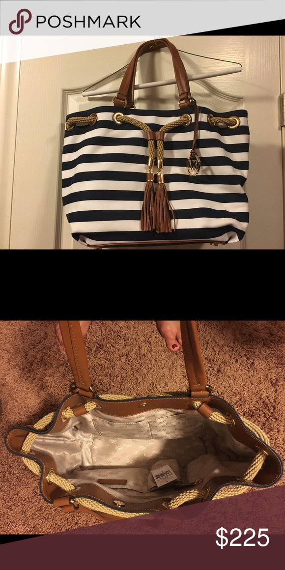 Michael Kors Purse Navy and white striped bag with leather handles. Authentic. Purchased for $268 and never used. Michael Kors Bags Totes