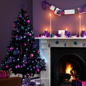 A purple and pink decorated Christmas tree.