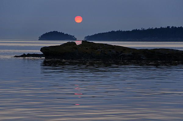 Sunset over Patos Island seen from the anchorage at Shallow Bay off Sucia Island