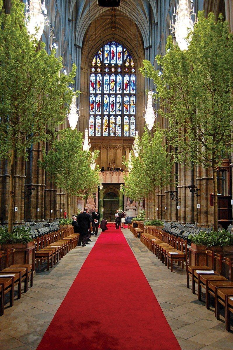 Wedding decorations inside church  Shane Connolly Flower Maestro  White wedding dresses Wedding