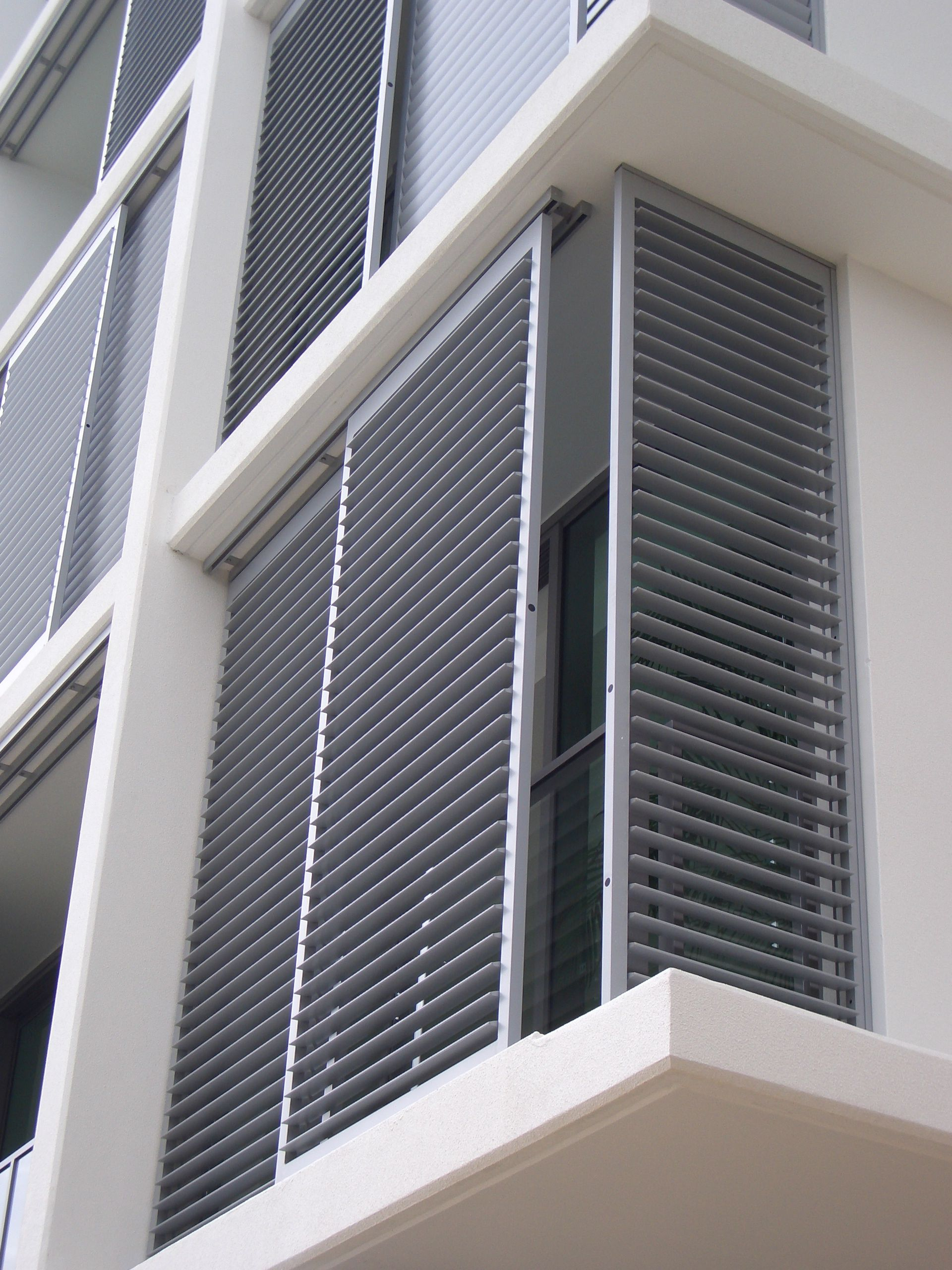 Exterior shutter enclosures the shade shop shutters screens security weather pinterest Aluminum exterior plantation shutters