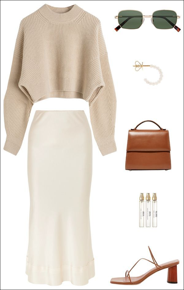 A Stylish Way to Wear a Silk Slip Skirt for Spring (Le Fashion) One of our favorite wardrobe staples for spring is the silk slip skirt. One of the most stylish ways to wear a white one this season is with a beige cropped sweater, square sunglasses, pearl hoop earr #lefashion