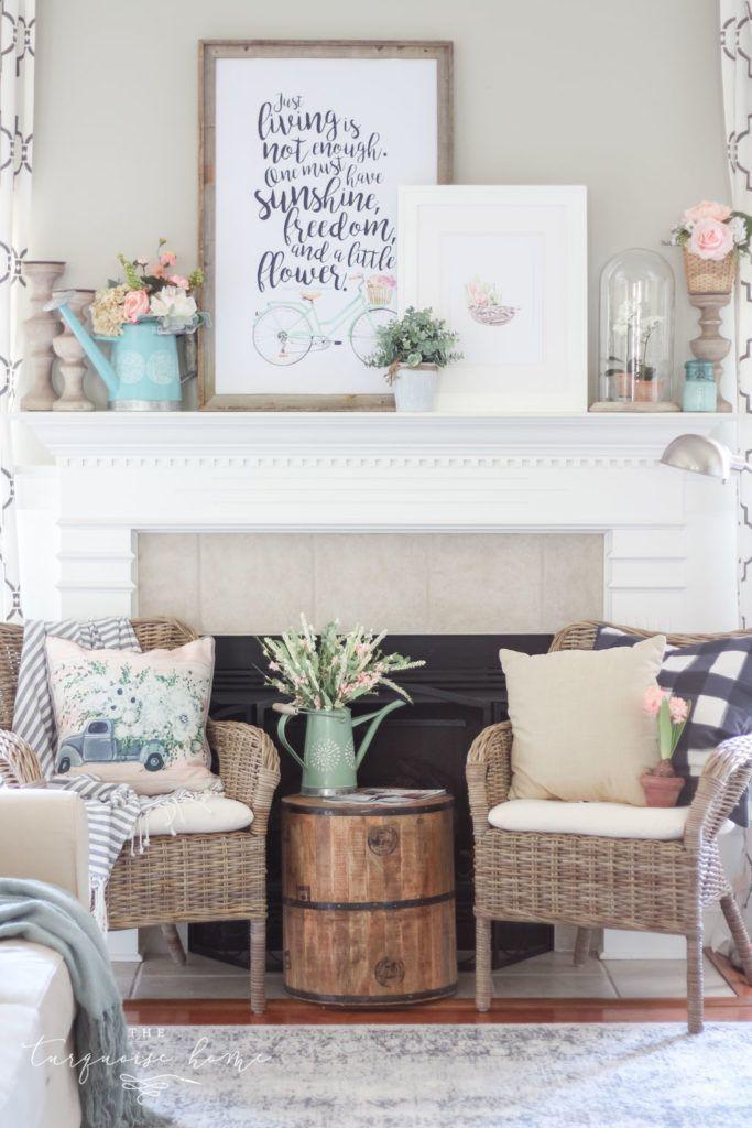Spring has sprung with this floral market vibe spring mantel decor! #springdecor #diyhomedecor #farmhousestyle #livingroomdecor #livingroomideas #manteldecor #springstyle