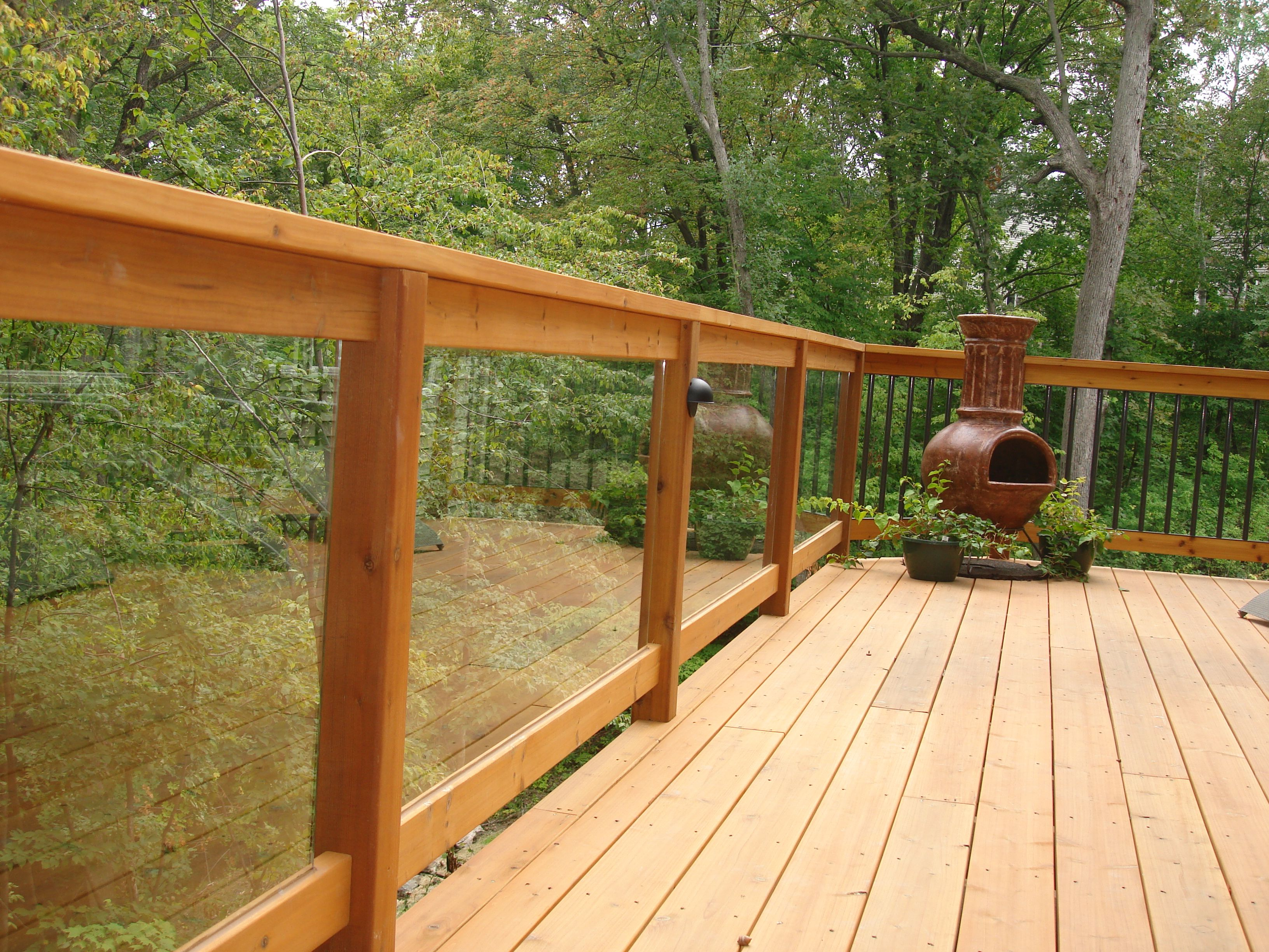 Cedar Railing With Glass Panel Inserts Built By Deck And Basement