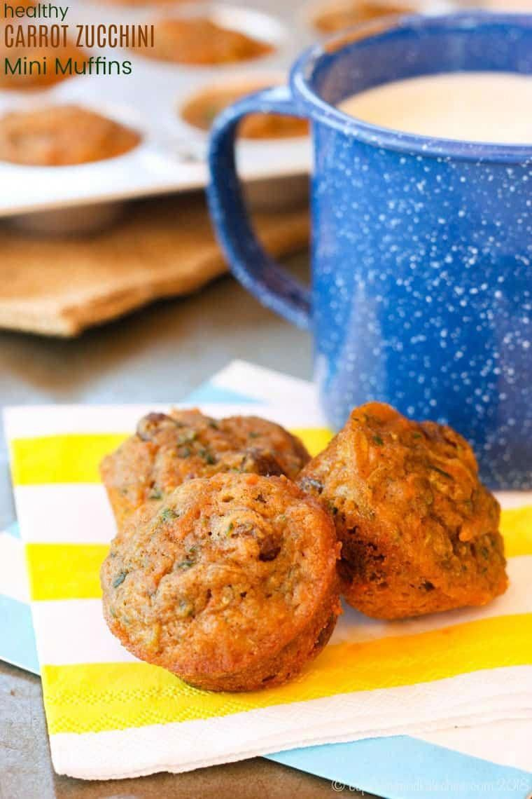 Whole Wheat Carrot Zucchini Mini Muffins - a healthy breakfast or snack that gets kids happily eating their veggies. This whole grain muffin is naturally sweetened with maple syrup, and freezes well. Readers love this recipe!