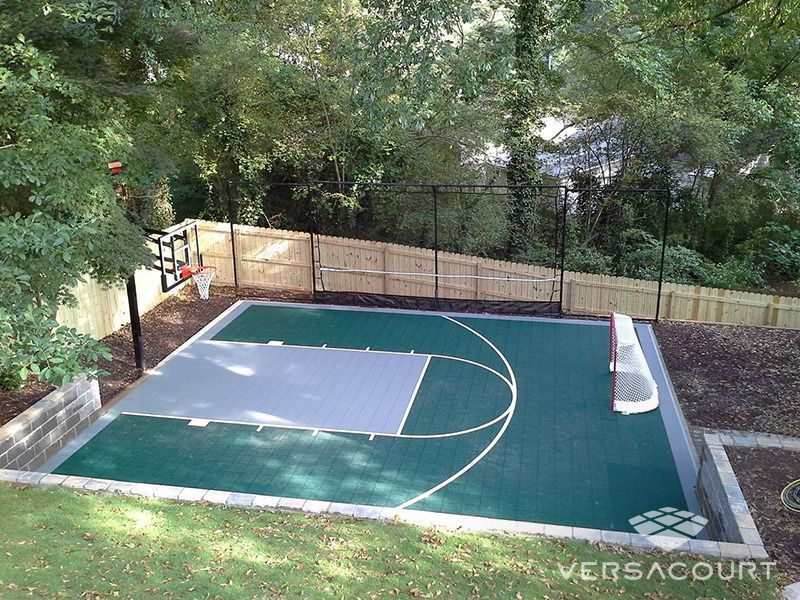 Backyard Basketball Court With Rebounder Hockey Net Basketball Court Backyard Backyard Basketball Outdoor Remodel