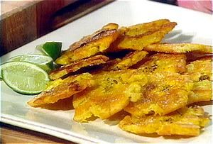 Tostones (fried plantains)...wonderful snack with beer, wine or other drinks...Recipe - http://nikas-culinaria.com/2006/02/01/how-2-guide-on-how-to-make-platanos-fried-plantains-or-tostones/