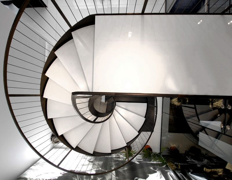 A helical stair with lateral stringer, rod balustrading and flat ...