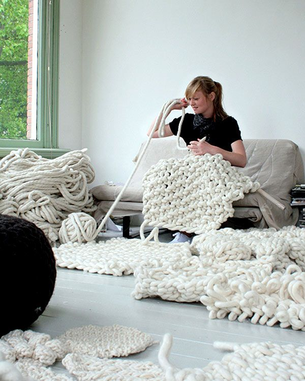 giant knitting  by Christien Meindertsma http://www.christienmeindertsma.com/  the picture clicks thru to the Anthology site where I first found it - a comment on Anthology says Christien makes her own yarn - she doesn't say anything about the process on her site but her work shown is quite amazing.
