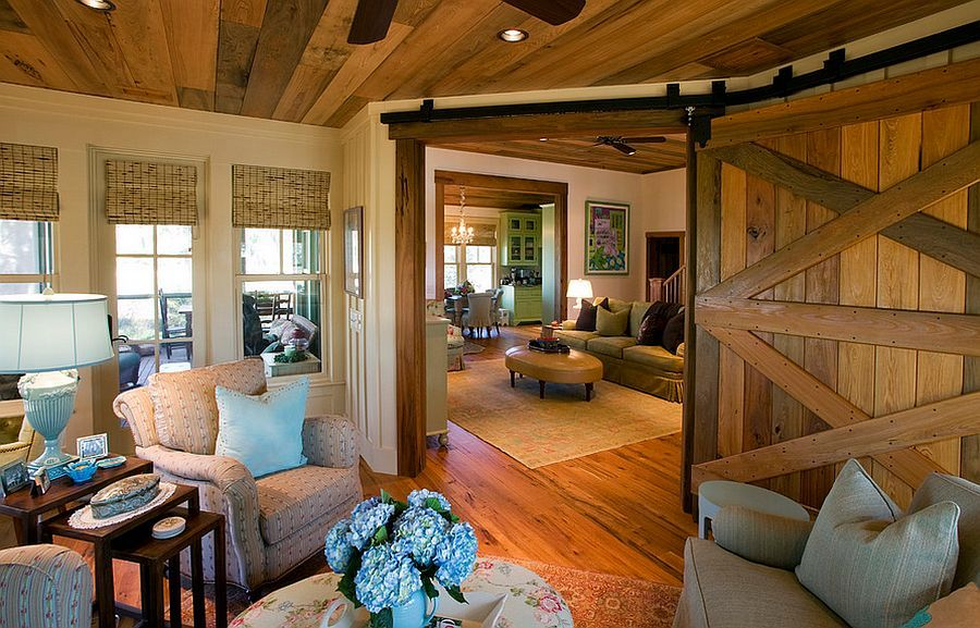 Add that country charm to the living room with a reclaimed barn door [Design: Gerald D. Cowart]
