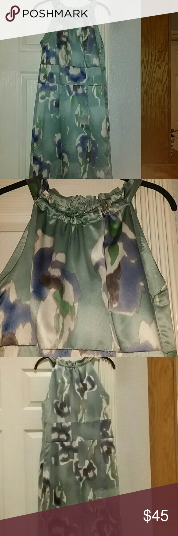 New - Ann Taylor Watercolor Midi Dress Sweet watercolor fabric that is stretchy. Well constructed dress. Like new. Size 14 Ann Taylor Dresses Midi