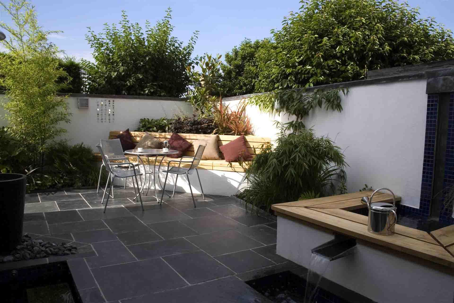Backyard outdoor garden with corner seating space complete for Contemporary backyard landscaping ideas