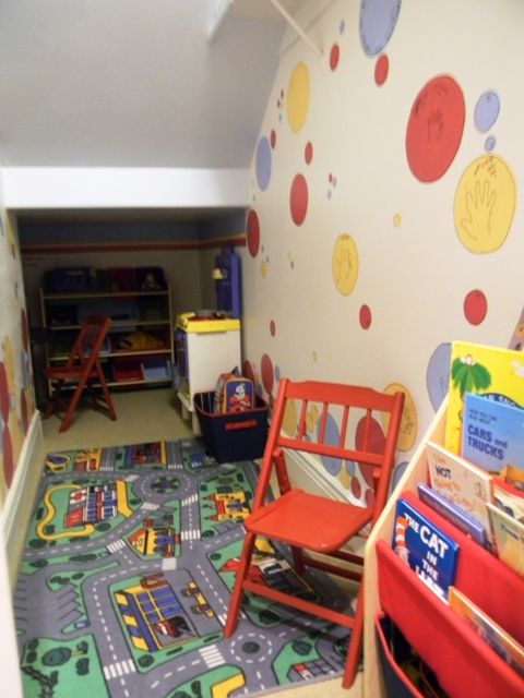 kids playroom under the stairs.