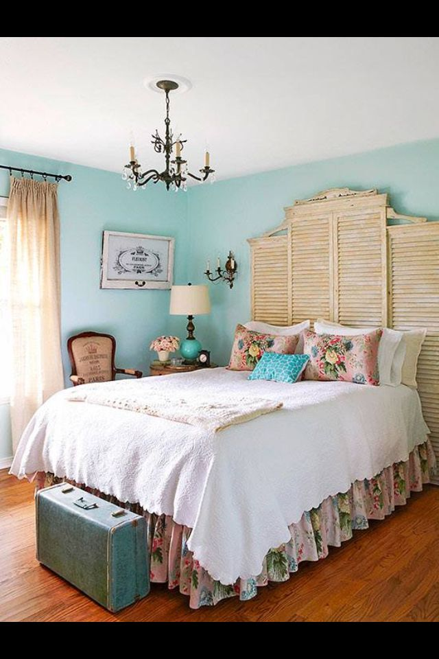 Distressed shutters add vintage style to this