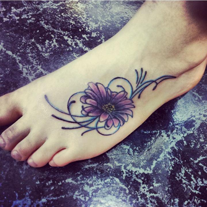Pretty daisy tattoo (3) daisy foot tattoo on TattooChief