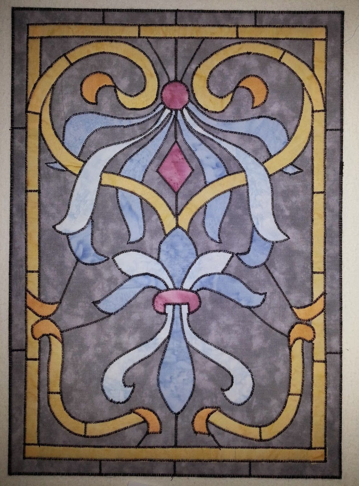 "Art Nouveau stained glass quilt by Marianne Bos : ""This piece is made using fusible applique with satin stitching"" .  Posted at Art Quilts Around the World."
