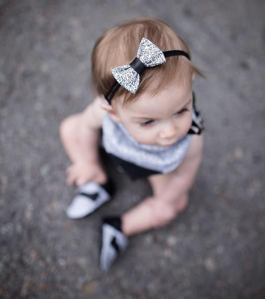 Please read the entire description thoroughly prior to purchasing. Gem print fabric bow with black leather accent and suede bands. Headband has an elastic stret