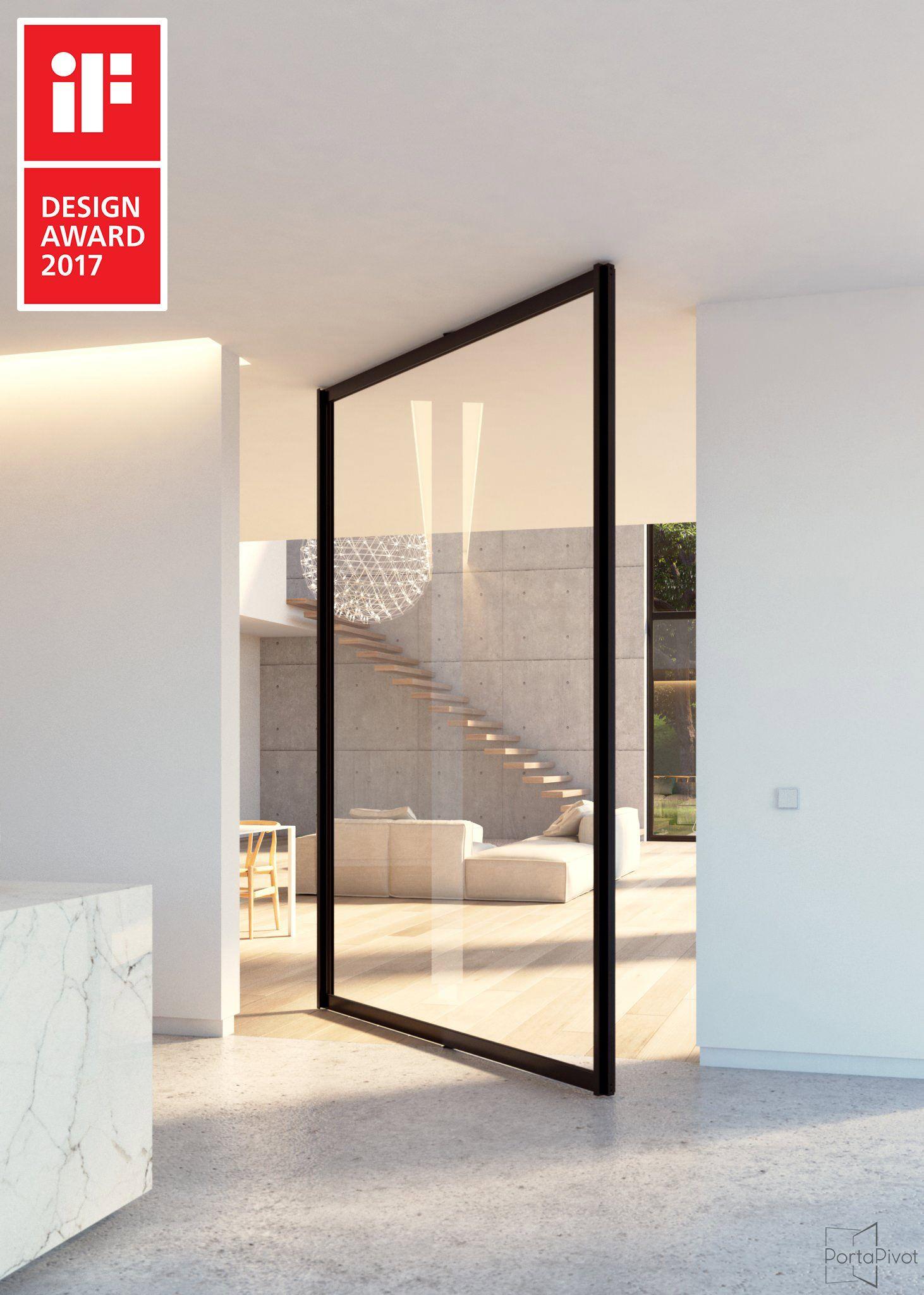 Glass pivot door with minimal black anodized aluminium frame. The ...